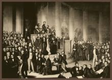 Die erste Deutsche Nationalversammlung in der Frankfurter Paulskirche (mit Jacob Grimm, links auf ein Blatt Papier zeigend)